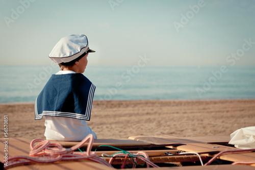 Obraz na płótnie Portrait of young sailor near yacht