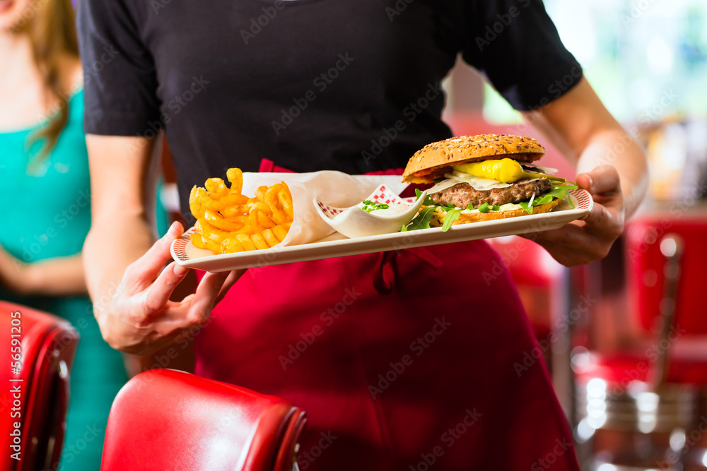 Fototapety, obrazy: Waitress serving in American diner or restaurant