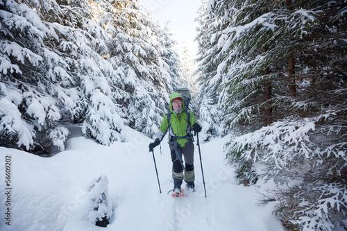 Fotobehang Wintersporten Hiker walking in winter Carpathian mountains