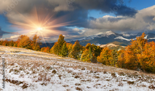 Poster Donkergrijs Colorful autumn landscape in the mountains. First November snow
