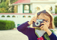 Little Girl Photographer Taking  Picture Using Vintage Film Camera