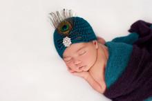 Newborn Baby Girl Wearing A Pe...