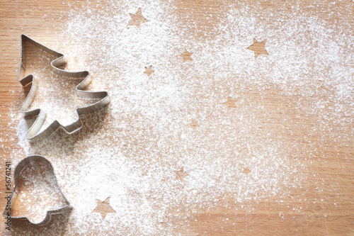 Fotografie, Obraz  Abstract Christmas food background with cookies molds and flour