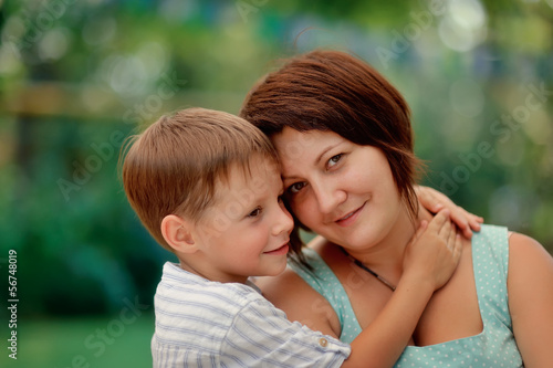 Fotografía  Portrait of an affectionate and loving mother kissing her baby s
