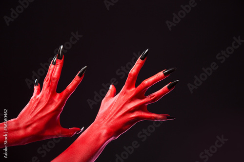 Carta da parati Spooky red devil hands with black nails, real body-art