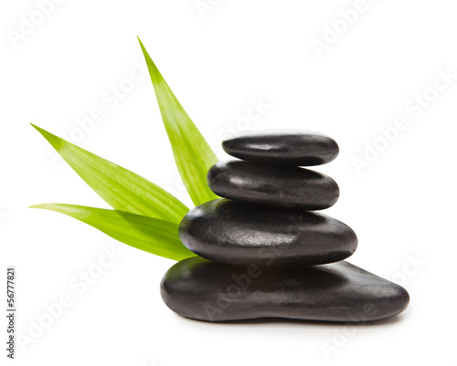 Deurstickers Zen Zen concept - pyramid of black stones and bamboo leaves