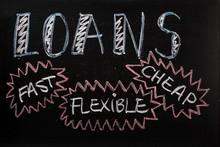 Loans Advertised On A Blackboa...