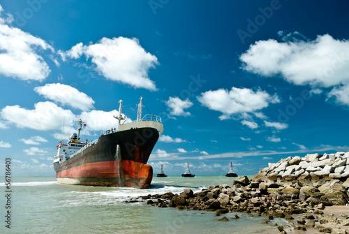 Photo Stands Ship Cargo ship run aground on rocky shore