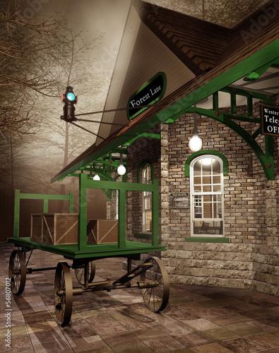 Obrazy na płótnie Canvas Stacja kolejowa z wózkiem i pudłami