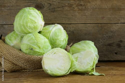 Valokuvatapetti ripe white cabbage on a wooden table