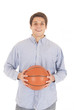 Handsome young man in blue dress shirt holding a basketball