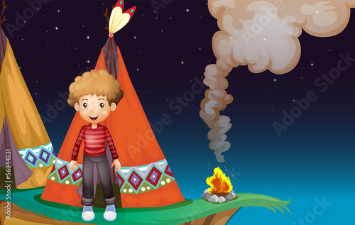 Photo Stands Indians A boy camping at the cliff in the middle of the night
