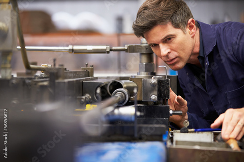 Fotografie, Obraz  Factory Engineer Operating Hydraulic Tube Bender