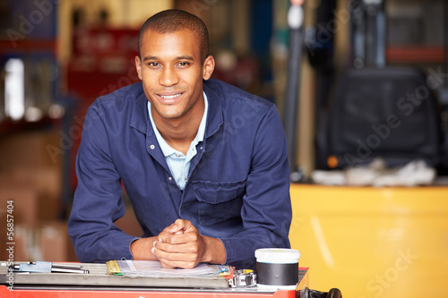 Portrait Of Engineer Standing In Factory