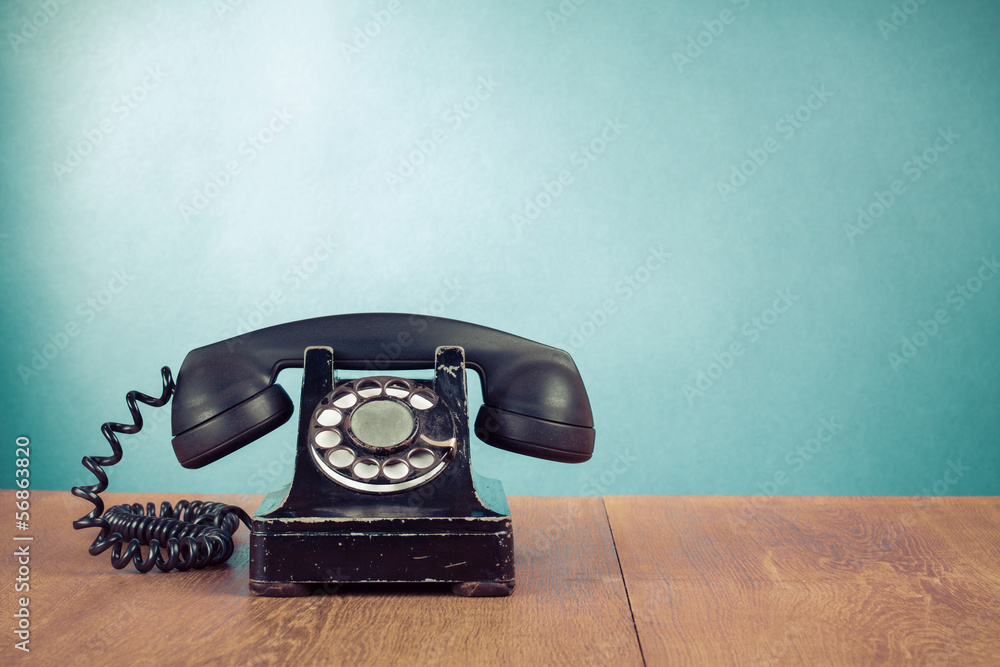 Fototapety, obrazy: Retro telephone on table in front mint green background