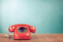 Retro Red Telephone On Wood Table Near Aquamarine Background