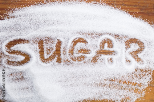 Fotografia, Obraz The word sugar written into a pile of white granulated sugar