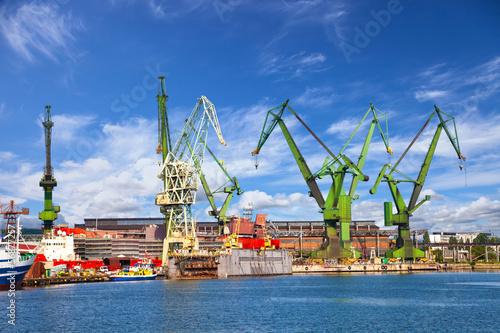 Photo Big cranes and dock at the shipyard of Gdansk, Poland.