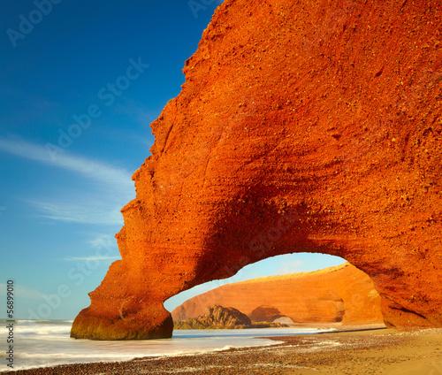 Fotobehang Baksteen Red archs on atlantic ocean coast. Marocco