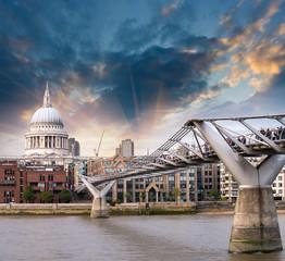 London, UK. Wonderful side view of Millennium Bridge at sunset,