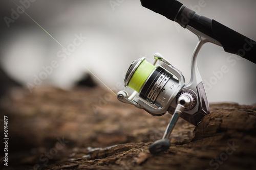 Printed kitchen splashbacks Fishing fishing reel. blur background