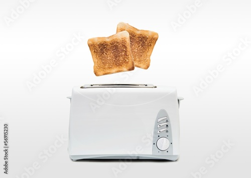 Jumping toasts. Preparing breakfast in modern toaster