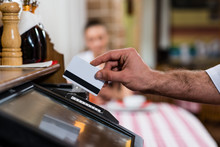 Waiter Inserts The Card Into A Computer Terminal