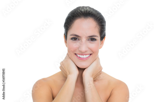 Fotografie, Obraz  Smiling bare brunette touching her neck with both hands