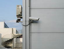 A CCTV Camera At The Corner Of...