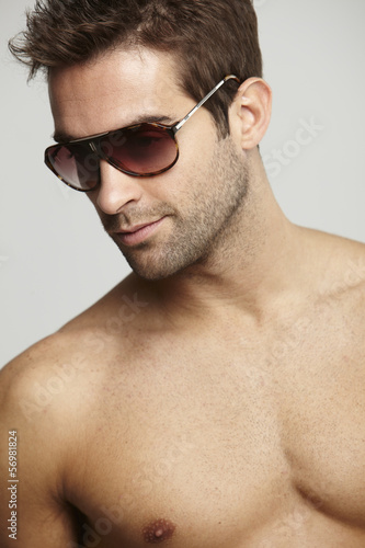 ba279519cf54 Mid adult man wearing sunglasses - Buy this stock photo and explore ...