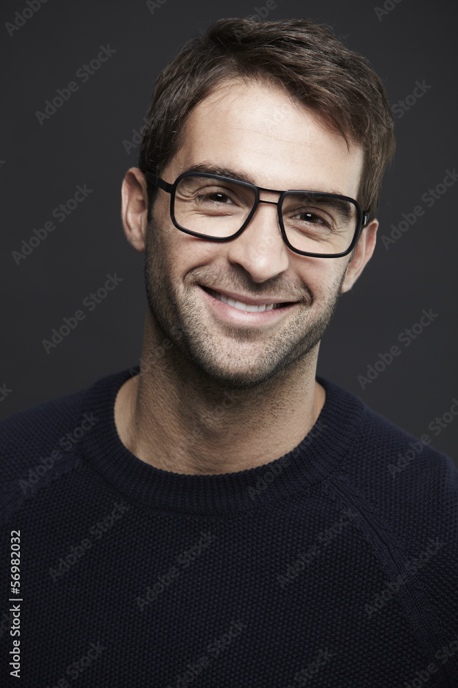 Portrait of mid adult man wearing glasses, smiling