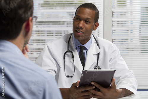 Fotografia  African American doctor with tablet and patient, horizontal