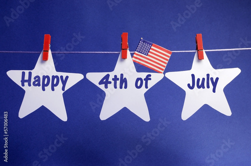 Fotografia  Happy Fourth of July stars from pegs on a line bunting