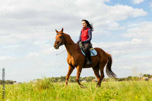 Papiers peints Equitation Young woman riding a horse