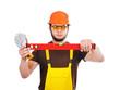 builder holding wasserwaage