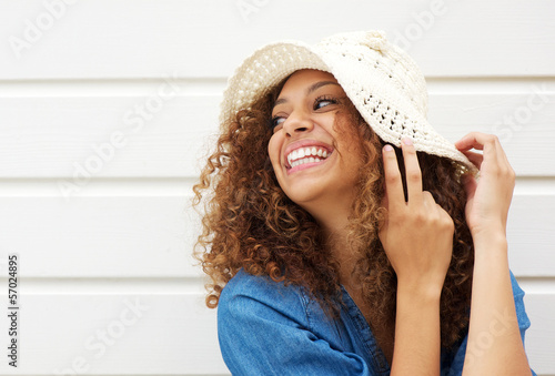 Fototapeta Beautiful young woman laughing and wearing summer hat obraz