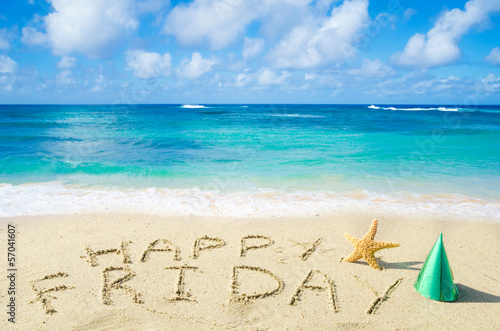 "Poster  Sign ""Happy Friday"" on the sandy beach"