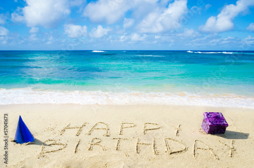 "Photo  Sign ""Happy Birthday"" on the sandy beach"