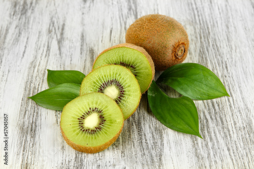 Fotografie, Tablou  Ripe kiwi on wooden table close-up