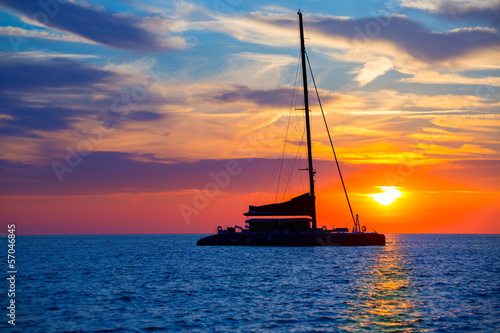 Ibiza san Antonio Abad catamaran sailboat sunset Fototapeta