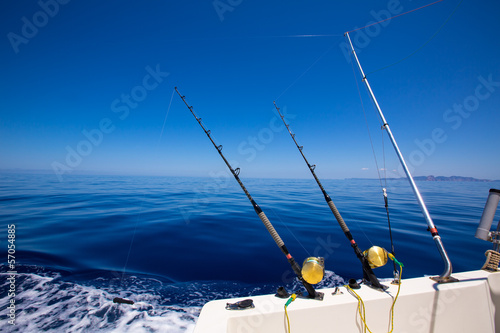 Ibiza fishing boat trolling rods and reels in blue sea