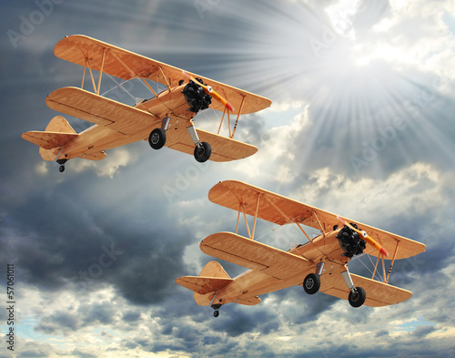 Photo Retro style picture of the biplanes. Transportation theme.