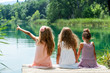 canvas print picture - Three girl friends together on river jetty.