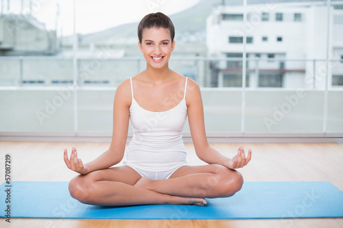 Fotobehang School de yoga Happy natural brown haired woman in white sportswear practicing