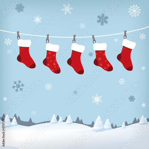 Photo christmas stockings in winter landscape