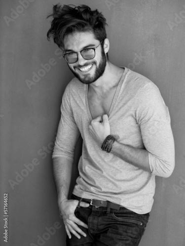 Plakat na zamówienie sexy man with beard dressed casual smiling against wall