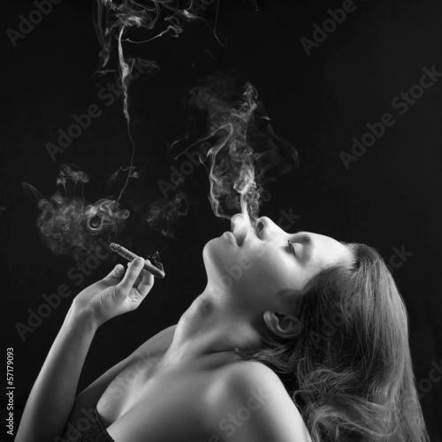 Fototapety, obrazy: Woman smoking cigar against dark background. Black and white stu