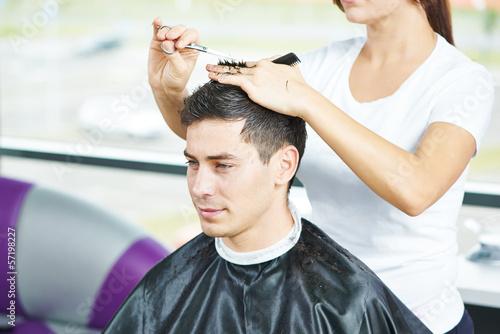 Male hairdresser at work