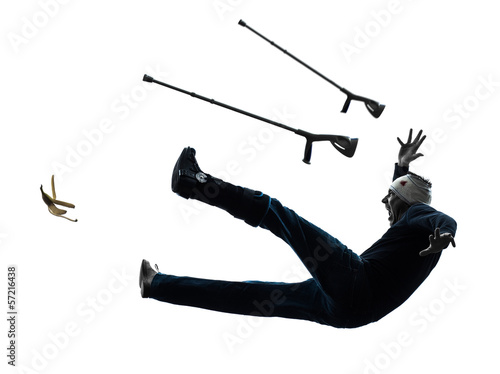 injured man with crutches slipping silhouette Wallpaper Mural