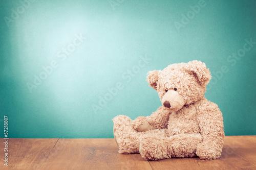 Fotografie, Obraz  Teddy Bear toy alone on wood in front mint green background